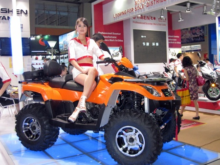 canto: Guangzhou, China - October 18, 2010  : Canto Fair China Import and Export Fair 2010, model with buggy Editorial