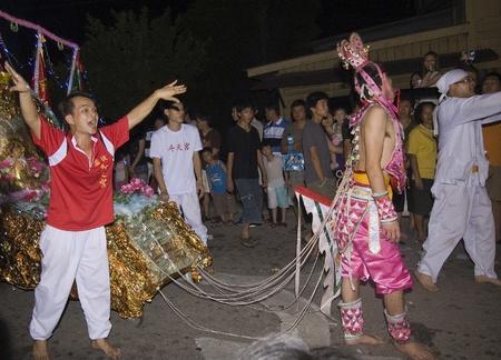 believers: Muar, Johor, Malaysia – November 14, 2010 : Nine Emperor Gods Festival ,  the in trance medium with his believers Editorial
