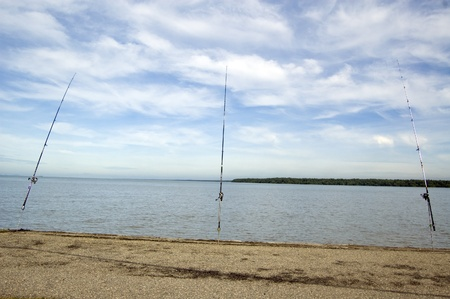 The three fishing rods and rails at the sea side waiting for a catch Stock Photo - 8399821