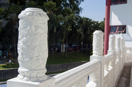 emboss: Temple Tian Hou, Kuala Lumpur, Malaysia, June 3, 2011  - the chinese decorative pilar fence which crafted with dragon emboss. Stock Photo