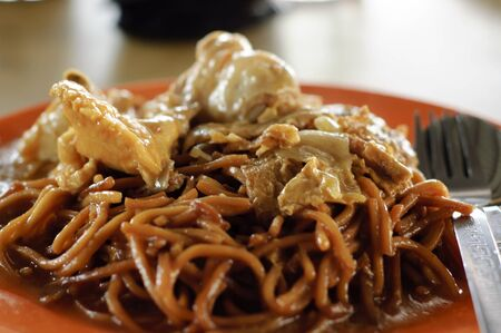 chinese noodle: A malaysia local food fried noodle with curry chicken