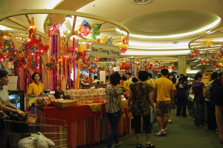 Kuala Lumpur, Malaysia, September 1, 2011 - Mid Autumn Festival booth selling mooncake and lantern at Mid Valley Shopping Center