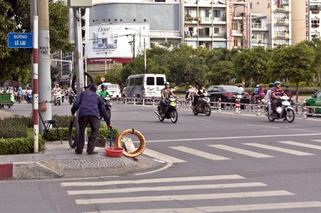 motorcars: o Chi Minh City, Vietnam , Oct 17, 2012 - The motorbike tires repair man at the main street