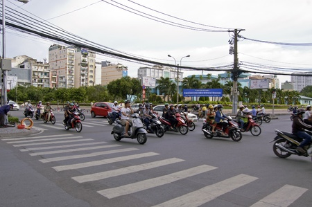 motorcars: Ho Chi Minh, Vietnam, July 3, 2012 - The busy street of Ho Chi Minh City where pack with motorcycle Editorial