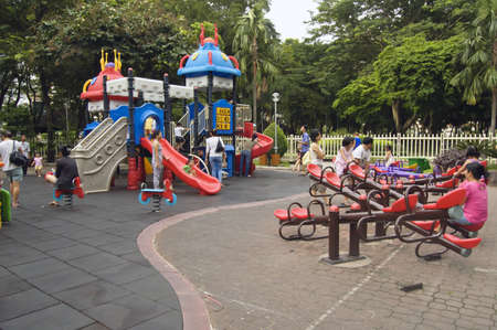 Ho Chi Minh, Vietnam, July 17, 2012 -  children and family playing in the playground
