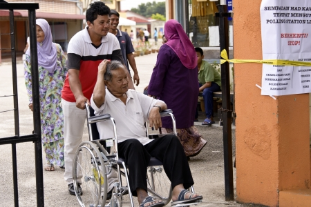 electing: Muar, Johor, Malaysia  - May 5, 2013 - the Election day for Malaysia 13th General Election