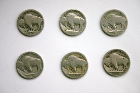 circulated: Buffalo Head Nickels against white BG Stock Photo