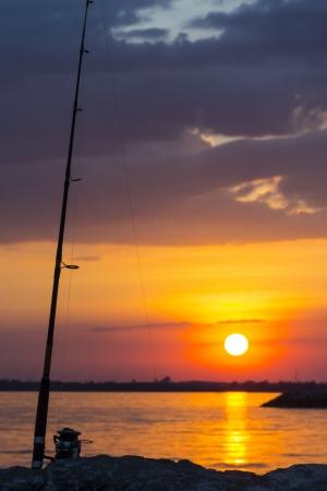 skie: fishing rod in twilight