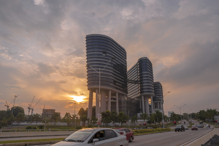 PUTRAJAYA, MALAYSIA - NOVEMBER 6, 2018: Malaysian Anti-Corruption Commission (MACC) headquarters at Putrajaya. MACC, is a government agency in Malaysia that investigates and prosecutes corruption during a beautiful sunset.