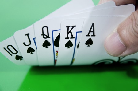 Hand of Royal flush in casino table