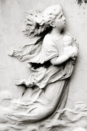Tombstone of a lady and a child Stock Photo