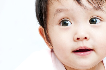 childishness: Close-up of a little baby girl Stock Photo