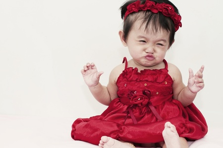 Little baby girl with funny expression photo