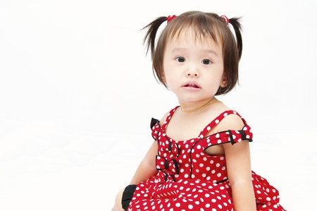 Little baby girl in red dress