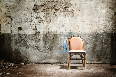 abandoned room: Empty chair and ray of light