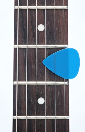 hardrock: electric guitar fingerboard with dot inlay and a pick  Stock Photo