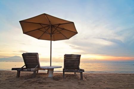 Sunrise and beach umbrella on Sanur beach, Bali