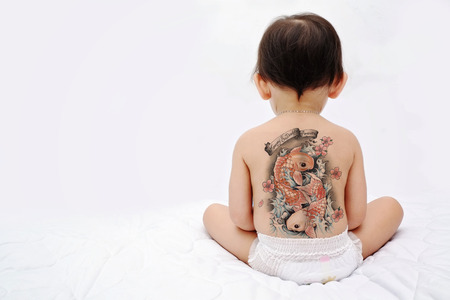 Little baby back with tattoo Stock Photo