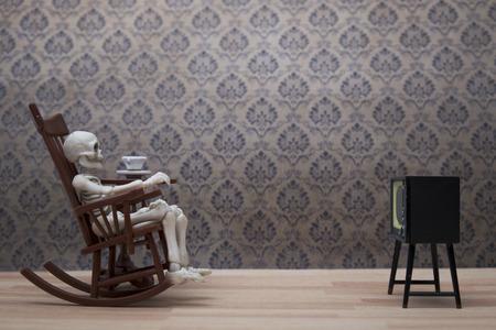 halloween skeleton: Skeleton - watching tv Stock Photo