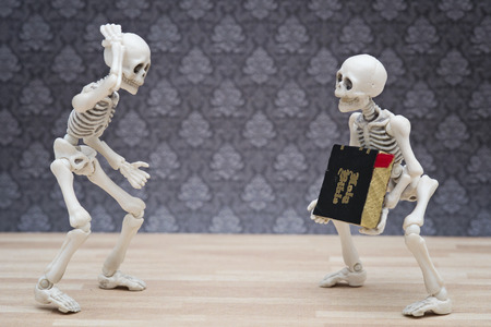 heavy: skeletons and heavy bible Stock Photo