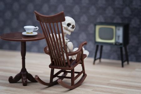ghost rock: skeleton watching TV