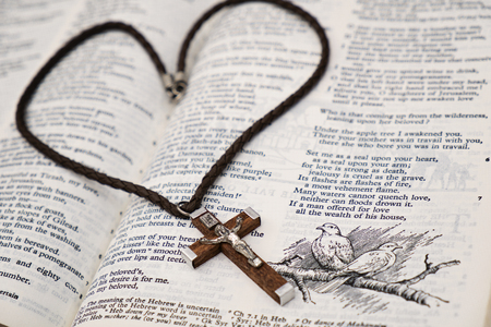 word of god: Wooden Crucifix pendant and Holy Bible Stock Photo