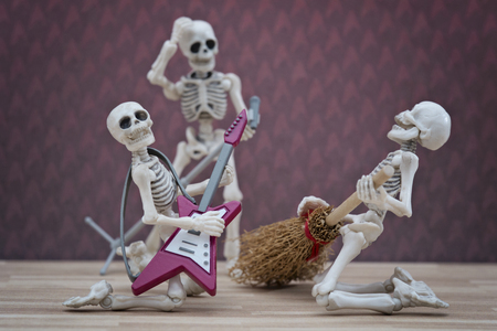 Skeleton playing broom as guitar with style