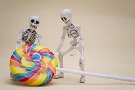 hauling: Two skeletons hauling lollipop