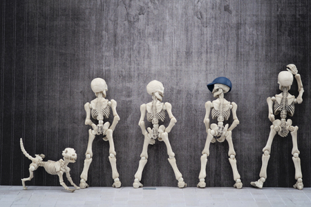 Skeletons pissing at the wall