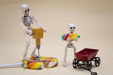hauling: Skeleton and skeleton kid hauling lollipop