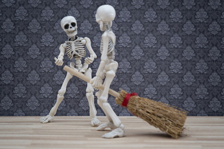 Skeleton sit on broom as witch Stock Photo
