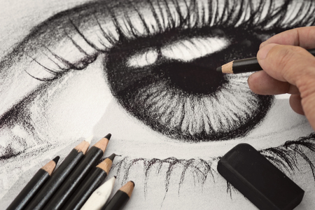 A hand drawing an eye charcoal artwork Imagens