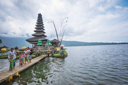 BALI, INDONESIA - March 24, 2017; Pura Ulun Danu Bratan is a Shivaite and water temple on Bali. This temple is used for offerings ceremony to the Balinese goddess Dewi Danu.