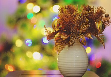 Christmas ornaments and Christmas lights in the background