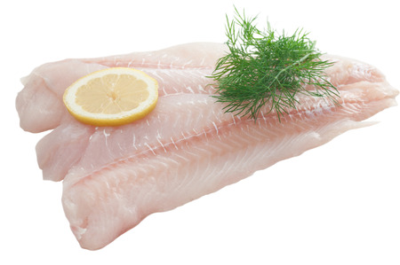 Raw cod fillet with dill and lemon slice  Stock Photo