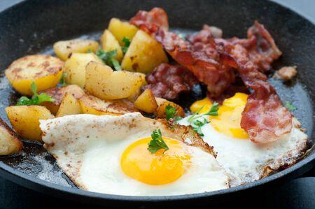 Fried bacon, egg and potato  photo