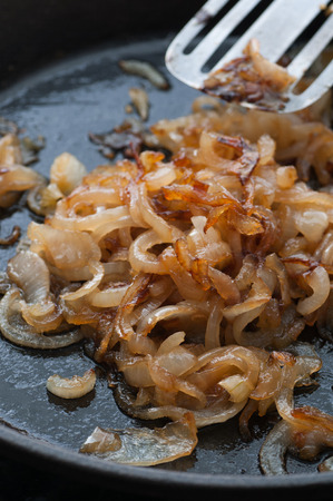 onions: Caramelized onion in a frying pan.