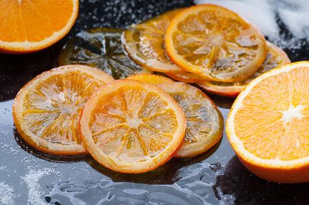 caramelized: Homemade caramelized organic orange slices. Stock Photo