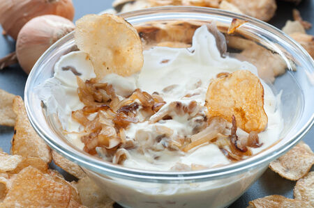 Caramelized onion dip with potato chips. Stock Photo