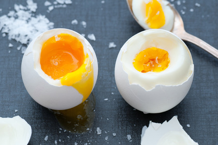 eggs: Soft boiled and hard boiled egg with sea salt. Stock Photo