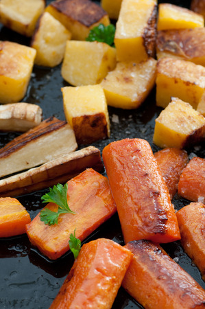 rutabaga: Roasted turnips, parsnips and carrots  with sea salt and olive oil. Stock Photo