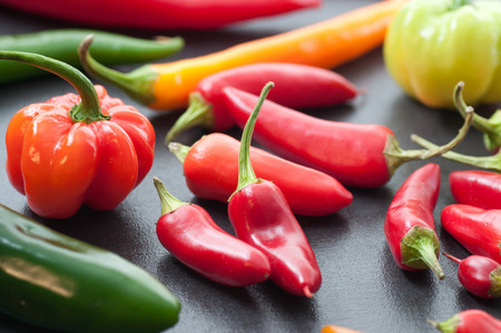 Various fresh hot chili peppers. Stock Photo