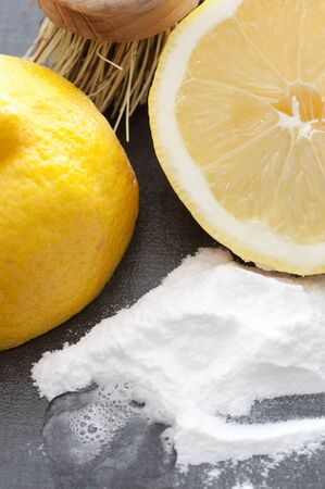 Baking soda, lemon and a brush.