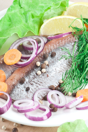 spanish onion: Pickled herring fillets with spanish onion and dill. Stock Photo