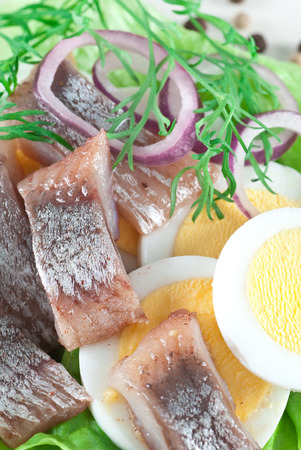 spanish onion: Pickled herring with egg, dill and spanish onion.