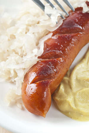 Bratwurst with sauerkraut and mustard. photo