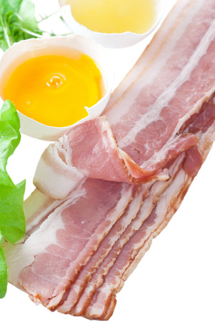 raw bacon: Raw bacon with egg and lettuce. Stock Photo