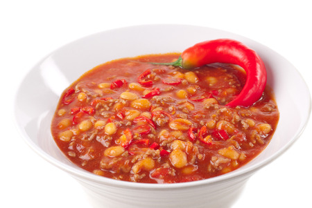 Spicy bowl chili with fresh chili pepper. Stock Photo
