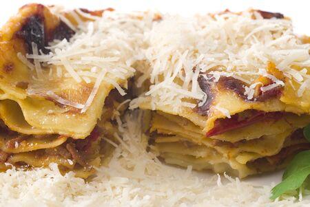 grated parmesan cheese: Lasagna with grated parmesan cheese.
