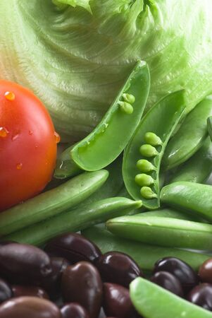 snaps: Salad ingredients. Sugar snaps, tomato, lettuce and black olives. Stock Photo